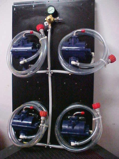 4 SHURflo Syrup Pumps with BIB Hose, BIB Connects and Secondary Regulator Mounted on Pump Panel