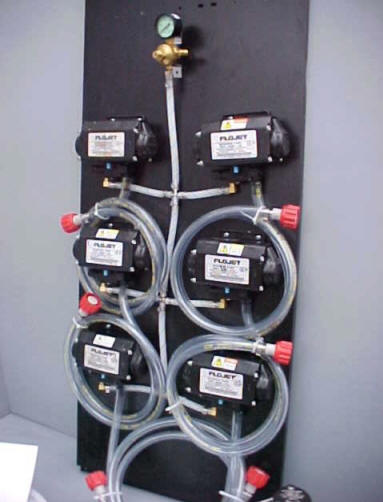 6 Flojet T5000 Series Pumps with BIB Hose, BIB Connects and Secondary Regulator Mounted on Pump Panel