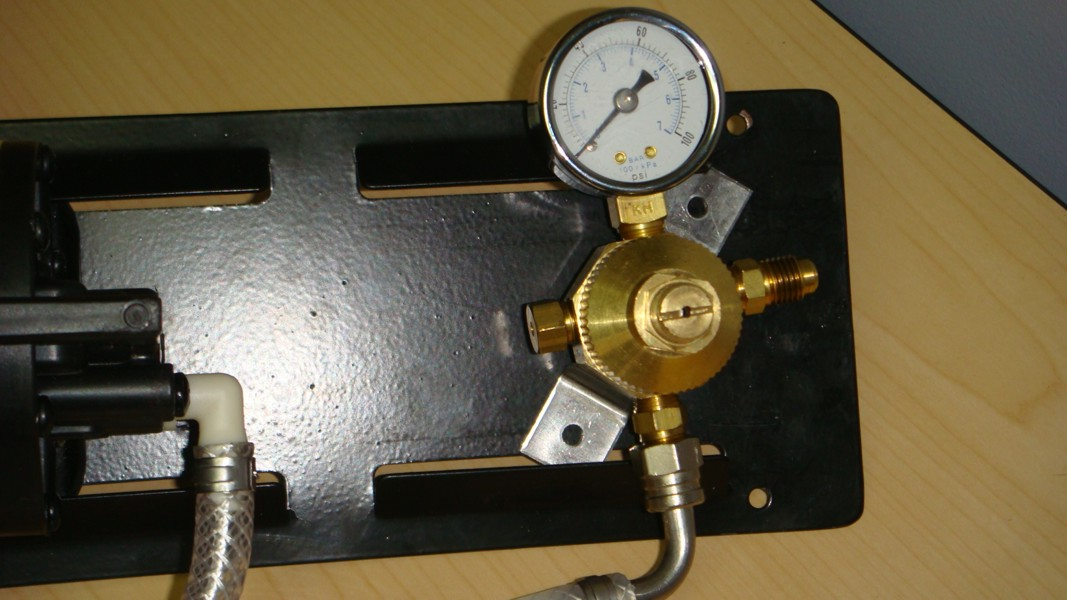 2 SHURflo Syrup Pumps with BIB Hose, BIB Connects and Secondary Regulator Mounted on Pump Panel